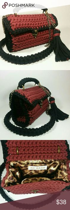 Chocolate Crossbody / Shoulder / Handbag Designed and hand crocheted by YouTuber Paint 'n Knit, this bag will add an artistic vibe to your outfit. It is made of chocolate and black T-shirt Yarn and lined with a luxurious animal print. KC Bags Bags Crossbody Bags