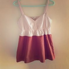 J Crew Tank Flirty J Crew pink and burnt orange tank. 100% cotton. Snaps on the straps to keep your bra from showing. Does seem to run big, as I am usually a 2 in J Crew tops. J. Crew Tops Tank Tops