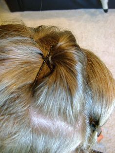 """Do's To Choose: Bump without the Bumpits ***No Back Combing*** Add bobby pins by using the """"X"""" method. To ensure the bobby pins are secured and the style will last all day, attach them to the base of the hair that is included in the pony. (Before elastic) That way it is sure to not go anywhere"""