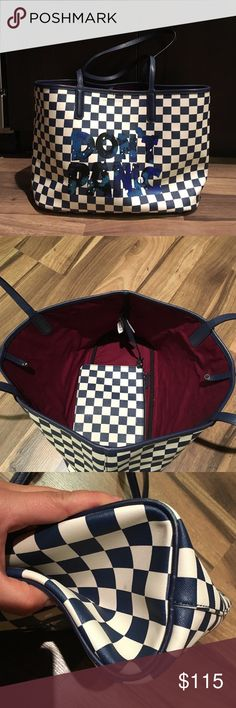 "Marc by Marc Jacobs tote Marc by Marc Jacobs Metropolitote tote with the words ""don't panic"" on the front. Bag had been worn a few times and still in very good shape. Clean interior with attached zipper pocket. Corners show some wear but the rest of the bag is clean. Bags Totes"