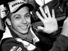 valentino rossi #46..Most certainly makes my VIP list by winning every level of GP motorcycle racing there has ever been.  Not too mention his infectious personality and down to earth lifestyle minus all the Ferrari's!  But who can blame him for having great taste in cars!