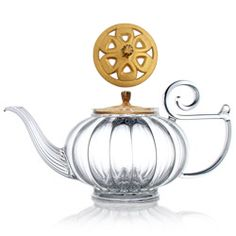 MY BEAUTIFUL TEAPOT glass teapot - cast-iron golden lid  Round, lofty, generously fluted and finely chased, MY BEAUTIFUL TEAPOT combines hand-blown glass with a cast-iron colourfull openwork cover. It brings to mind all the delights of a mild flirtation, just as it brings to the mouth rich flavours and heady aromas. In its wake it leaves an evocative swirl of shared moments and soft light.  Numbered teapots - Made in France - registered design volume : 1 l.