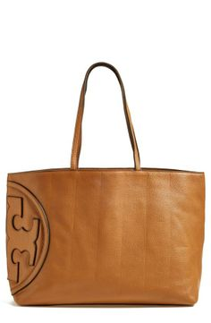 This oversized Tory Burch tote is absolutely gorgeous! Love the timeless style and iconic logo medallion.