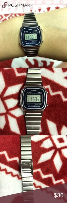 Casio Digital Watch Casio digital watch I bought from American Apparel. The battery doesn't need changing yet, it's still ticking! Stainless steel adjustable strap with a navy blue face. Watch is in working condition without much wear. Just want to repeat that the band is adjustable it's a little tough to change it but it's doable. Casio Accessories Watches