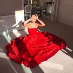 Bella Hadid in Dior Haute Couture Red Gown at Cannes - Bella Hadid's Audrey Hepburn Moment at Cannes Film Festival 2017