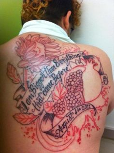 pomegrenate and flower tattoo