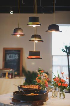 Very creative - hats as shades for hanging light bulbs