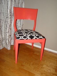 coral painted chair and black and white fabric