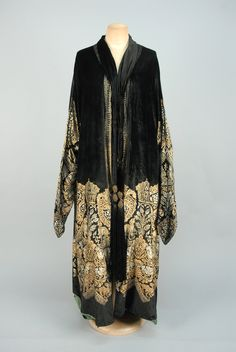 Black silk stenciled in a metallic silver and gold Medieval pattern having dogs, birds and griffins, narrow pointed sleeves, self tie at neck with metallic gold and silk tassels, green silk faille lin. 20s Fashion, Art Deco Fashion, Fashion History, Vintage Fashion, Edwardian Fashion, Vintage Outfits, 1920s Outfits, Vintage Dresses, Vintage Fur