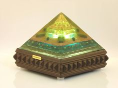 Abundance Orgone with Sri Yantra in the bottom. This pyramid has been specially created to radiate the frequencies of abundance.