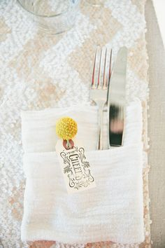 billy button tucked into the place settings, photo by Onelove Photography http://ruffledblog.com/1920s-inspired-ace-hotel-wedding #weddingideas #billybutton