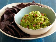 Truly, the best guac I've ever had, and so easy to make.  Rachel Ray's Garlicky Holy Guacamole!
