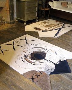 'Abstract XXX'. Based on ink and collaged paintings by the artist Philip Owen. These two rugs can be separate (as seen) or interlocked. I used various wools including some very fine two-ply worsted wool to create fine trace lines.  Hand tufted rugs by Annette Turner. Each rug 130cm by 180cm.