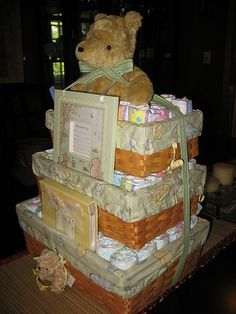 Hmmm Love this idea too. With the baskets you can change from diapers to bibs to onsies. And I would love the baskets for storage after!!! Classic Pooh Basket Diaper Cake by swaddlestar, via Flickr