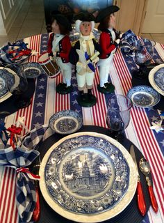 Stars & Stripes table features Liberty Blue vintage dishes. Centerpiece is trio of Byer's Choice figures - George Washington with fife and drummer.