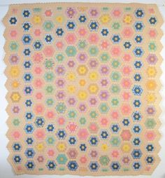 "Grandmother's Flower Garden Quilt: Circa  1930. Organized, symmetrical use of color as well as the small size of the gardens. In addition, it is done on an ecru ground, rather than the more usual white. Measurements are 86"" x 96"""