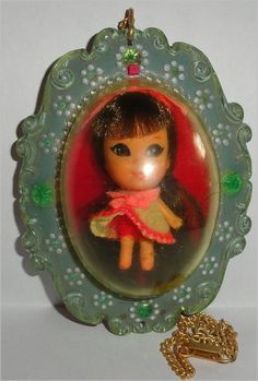 Vintage Little Kiddles dolls, so tiny!  The locket was a necklace.