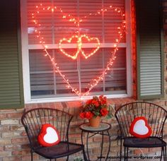 Valentines Day lighting: create glowing hearts with red string lights. Romantic lighting idea using sting lights from Christmas storage!