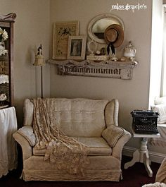 Corner-LOVE the old shelf and the way the things are arranged on it. Love the small table and old typewriter. Love the floor lamp. What a comfy place to curl up with a good book.