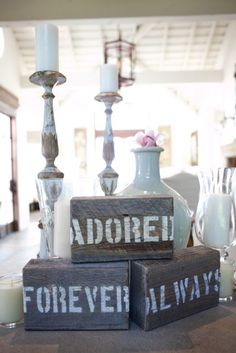 These can be homemade out of 2x4's, stencils and white acrylic paint for cheap....good decorations for a country themed/simple wedding...