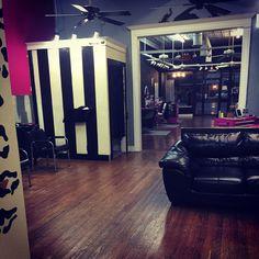 Retro Garage Salon waiting area. New salon Bold Paint Scheme. Leopard And Striped Walls
