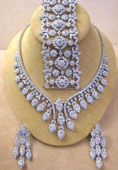 TRULY AWSOME BRIDAL NECKLACE WITH MATCHING EARRINGS WITH EYE CATCHING LOOKS. THE NECKLACE SET HAS A VERY HEAVY LOOK AND ITS MADE UP OF 92.5 STERLING SILVER AND STUDDED WITH AAA GRADE OF CZS ( SIMUL ..