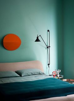 The Color Wheel: Your Guide to Choosing Perfect Paint Schemes; Blue/teal walls & ceiling, orange highlights