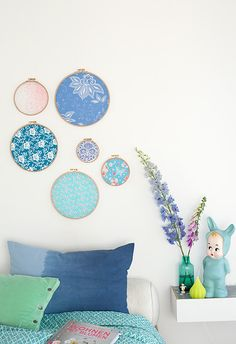 Beautiful color and fabric selection in these embroidery hoops wall decor.