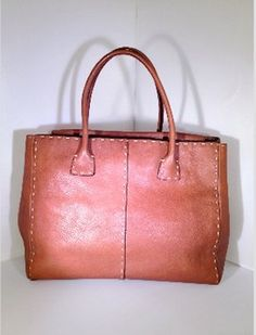 Adrienne Vittadini Leather Stiched Handheld Fashion Caramel Tote Bag. Get one of the hottest styles of the season! The Adrienne Vittadini Leather Stiched Handheld Fashion Caramel Tote Bag is a top 10 member favorite on Tradesy. Save on yours before they're sold out!