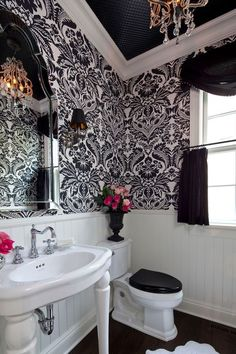 "Cottage Powder Room with Console Sink, Majestic Black and White Wallpaper, Uttermost Hovan 44"" High Wall Mirror, Wall sconce"