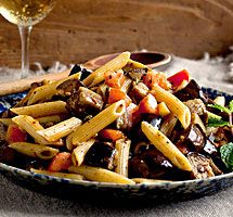 A roasted eggplant, tomato and mint penne dish makes for a bright, intensely flavored pasta salad that could be nibbled right out of the pan, then snacked on between cocktails and conversation. Real Food Recipes, Yummy Food, Healthy Recipes, Penne Recipes, Vegetarian Main Course, Pasta Salad Italian, Salad Bar, Pasta Dishes, Stuffed Peppers
