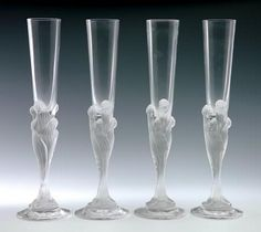 "Роман Тыртов ""Erte"" 1892-1990 Suite of Four Frosted Crystal Champagne Flutes Each modelled a cluster of veiled women resting on circular spreading foot, acid etched signature to base, height 30.5 cm"