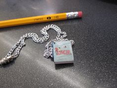 Fangirl by Rainbow Rowell Necklace made by Ms Katie! Pencil made by a factory. (request the book here: x)