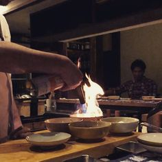 Smoking with fire. (Burning hay so as to smoke the fish and root vegetable.) #girogirokagurazaka #girogiro #japanese #restaurant #Chef #cook #kitchen #japan #tokyo #kaiseki #omasake #lidabashi #smoke #hay #fire #bowl by croatoa