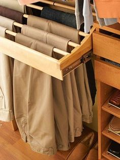 "Better Homes and Gardens - The Ultimate Walk-In Closet. Pants Organization and Storage. ""A wooden pullout trouser rack holds 10 pairs of freshly pressed pants. The attractive display lets you clearly see each pair. The dowels lift out for easy access. Closet Bedroom, Master Closet, Closet Space, Walk In Closet, Bedroom Decor, Wardrobe Closet, Bedroom Curtains, Dance Bedroom, Smart Closet"