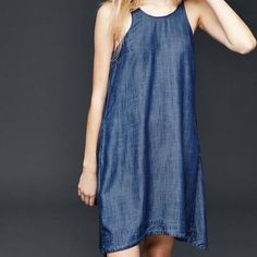 Gap Denim Swing Dress Sleeveless swing dress with pockets. Flattering fit. Racerback like top. Perfect warm weather frock. Fits true to size. Initial picture for styling purposes. Actual dress in pictures following cover shot. GAP Dresses