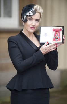 This butterfly fascinator she sported at an event in 2012 looked gorgeous with her crimson manicure.