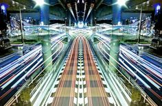 """Japanese photographer Shinichi Higashi takes great long exposure shots of Tokyo and its urban architecture. The result is a series of """"Graffiti of Speed / Mirror Symmetry"""" with talent that uses replication and symmetry to discover more."""
