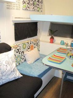 1963 travel trailer - I like the way the couch and bench seats have a different look.