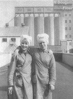 Taking a fag break outside of McDougall's Self-Raising Flour factory on the Isle of Dogs, c. 1960s.