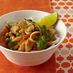 Creamy reduced-fat peanut butter and a bit of red curry paste make this Slow Cooker Thai Chicken smooth and not too spicy #slowcook #chicken #thai