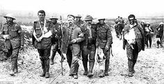 British soldiers wounded in the trenches on the Western Front during the First World War m...