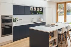 Close up of white and inky blue handleless kitchen by Newhaven Kitchens. Open Plan Kitchen Living Room, New Kitchen, Kitchen Dining, Dining Room, Handleless Kitchen, Self Build Houses, Newhaven, Kitchen Planner, Cool Kitchens