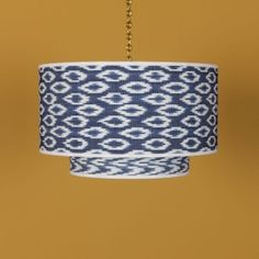 An authentic Ikat Drum lampshade from our Maya Collection. The Ikat fabric is created using traditional methods. It is then dyed in Indigo and when the binds are untied the pat Antique Lighting, Industrial Lighting, Modern Lighting, Wall Lights, Ceiling Lights, Bespoke Design, Murano Glass, Drums, Ikat Fabric