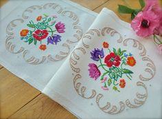 Check out this item in my Etsy shop https://www.etsy.com/uk/listing/513173594/hand-embroidered-floral-vintage-rayon