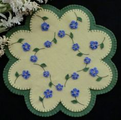 Forget-Me-Nots Wool Candle Mat Pattern http://www.cathspenniesdisigns.com