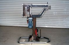 """Adjustable Bead Roller by Heatnbeat -- Here are some pictures of my bead roller I made. The upper shaft moves in/out 1-1/4"""" it helps align  Different dies. Powered by a 1/4 HP 3 phase gear motor 98:1 ratio. I'm using a 110volt VFD to run the motor, Adjust the speed, and control forward and reverse (by 2 foot pedals). I used a #40 chain from the motor to the lower shaft.from the lower shaft to a middle shaft. Then I used two 2"""" spur gears with a 1-1/4 face to turn the upper shaft So I have…"""