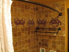 Happy 40th Birthday, Atari. (how about celebrating by redoing your bathroom in a video game theme? i LOVE this Space Invaders mosaic.)
