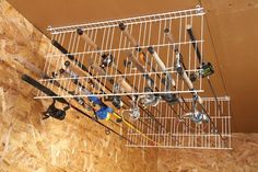 Fishing Rod Ceiling Organizer  or mount to a wall with the lower rack off the floor enough for the handles to rest on the floor.