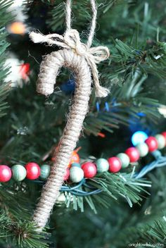 Twine wrapped candy canes with a bow to make pinterest candy 21 turnt up diy ornaments you need to make before 2015 publicscrutiny Choice Image